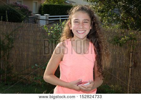 Beautiful Brunette Teenage Girl With An Orange Shirt
