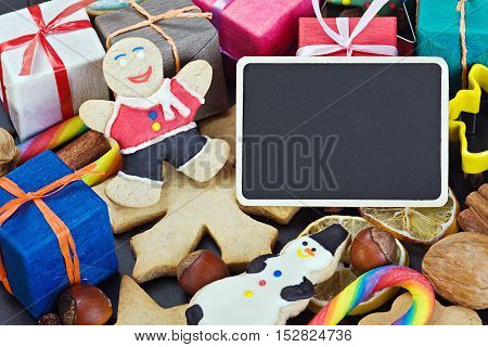 smiling on the background of Christmas gingerbread decorations for the holiday