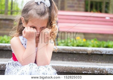 outdoor portrait of young child girl on natural background