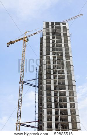 construction of a skyscraper on a background of blue sky