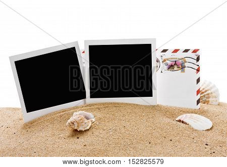 empty photo frame and a letter from vacation in the sand