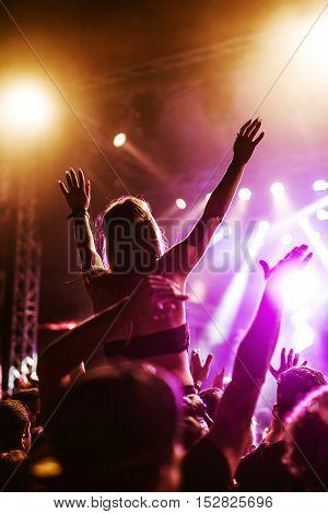 Raising Her Hands