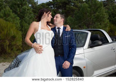 Beautiful Newlywed Couple Posing Near Rconvertible Car