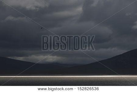 Dramatic landscape line of sunlight on the lake, Sarek, Sweden