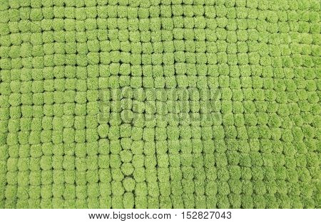 Fabric Texture Close Up of Green Plush Fabric Texture Pattern Background.