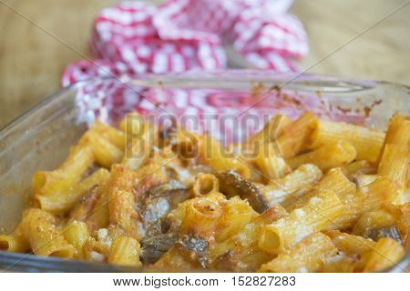 pasta bake with leftover vegetables in a glass baking tray