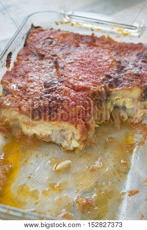sicilian parmigiana made with slices of aubergines and filling of eggs and mozzarella