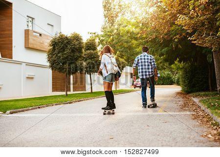 Longboard Couple Enjoying Sunny Day