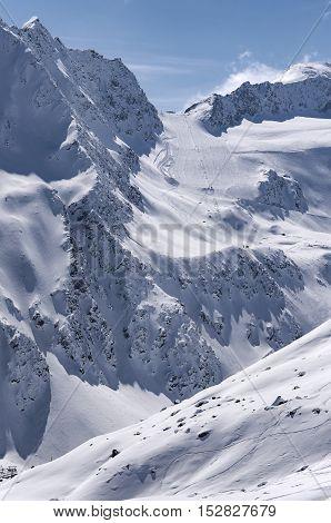 Ski lift run and piste on Rettenbach Glacier in Solden ski resort in Otztal Alps in Tirol Austria