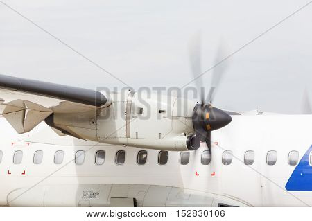 Turboprop engine and propeller passenger plane on the runway