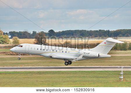 Borispol Ukraine - October 2 2011: Bombardier BD-700-1A10 Global Express XRS business jet a moment before the touchdown