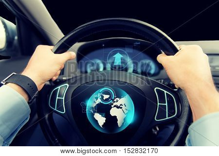 transport, business trip, navigation and people concept - close up of male hands holding car wheel and driving with globe on board computer screen