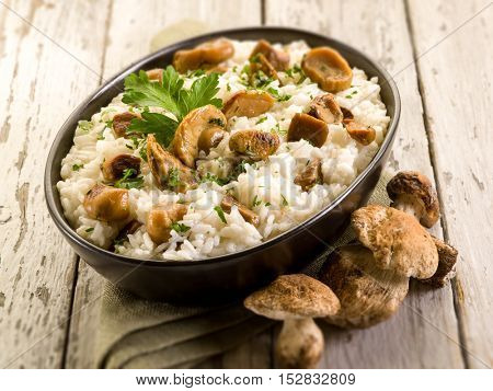risotto with cep edible mushrooms, selective focus