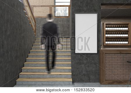 Rear view of man climbing stairs of restaurant. Concrete walls white poster near brick segment of wall. 3d rendering. Mock up