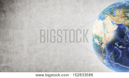 Planet Earth in right part of screen against concrete wall background. Mock up.