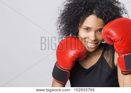 Woman In Black Tank Top With Red Boxing Gloves