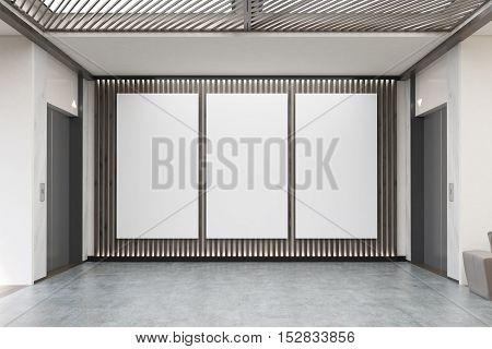 Three Large Vertical Posters In Office Lobby