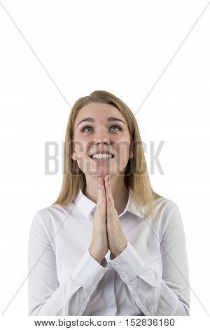 Close up of blond woman with her palms held together near her face. She is looking upwards and waiting for the wonder to happen. Isolated. Mock up