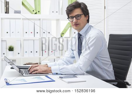 Young Successful Businessman In White Office