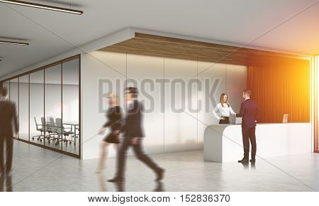 Colleagues in corridor of office with reception counter and meeting room with glass doors. Concept of comfortable workspace. 3d rendering. Mock up. Toned image.