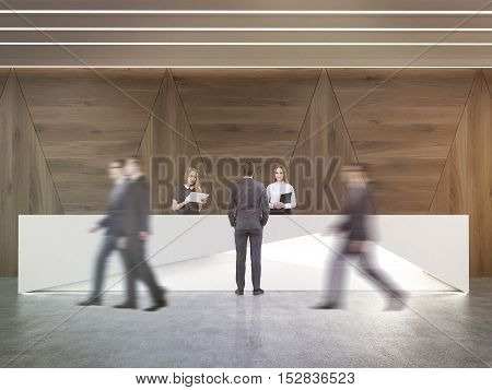 Rear view of man talking to receptionists in room with dark wood walls and concrete floor. His colleagues are passing by. Concept of business communication. 3d rendering.