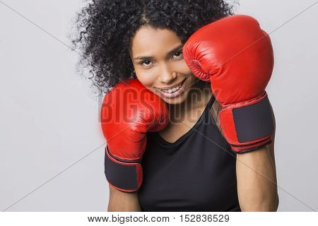Close Up Of Cheerful Woman In Fight Stand With Red Boxing Gloves