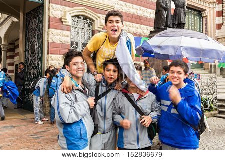 COLOMBIA, BOGOTA - CIRCA MAY 2013: Teenagers leaving school in Bogota, Colombia