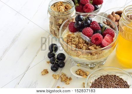Delicious breakfast with granola berries yogurt and seeds. Vegetarian food diet and health concept.