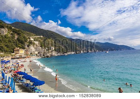 MONTEROSSO AL MARE, ITALY - SEPTEMBER 20, 2016: Unidentified people at Monterosso al mare in Italy. It is one of the five towns that make up the Cinque Terre region
