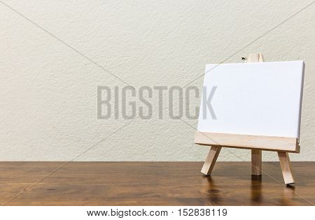 Empty blank whiteboard on the wooden table