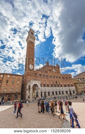 SIENA, ITALY - SEPTEMBER 21, 2016: UInidentified people at Piazza del Campo in Siena Italy. It is one of Europe's greatest medieval squares