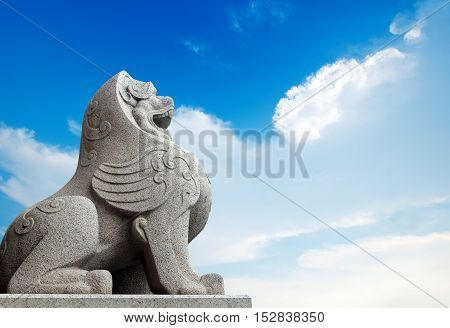 Traditional Chinese stone lions Bund in Shanghai before the old building.