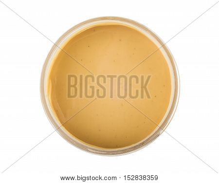 Opened Plastic Jar With Peanut Butter Isolated On White