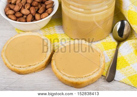 Sandwiches With Peanut Butter, Plastic Jar And Bowl With Nuts