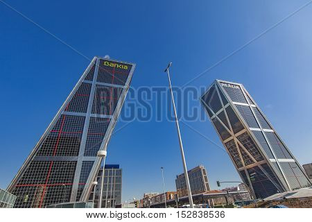 MADRID, SPAIN - MARCH 16, 2016: View at Plaza De Castilla with Puerta de Europa Towers in Madrid Spain. Towers have a height of 114 m and were constructed from 1989 to 1996