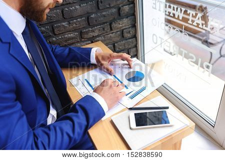 freelancer in costume working with papers indoors