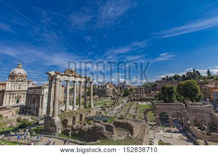 ROME, ITALY - SEPTEMBER 24, 2016: Unidentified people at Roman forum in Rome Italy. Roman Forum is surrounded by ruins of several important ancient government buildings at center of Rome