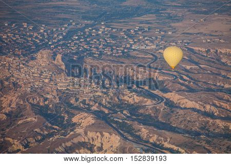 Color image of a hot air balloon flying in Cappadocia Turkey at sunrise.