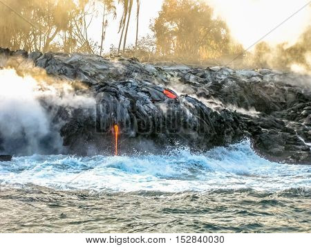 Volcanic activity of Kilauea Volcano in Hawaii Volcanoes National Park, Big Island, United States. Sea view of lava rivers into the Pacific Ocean.