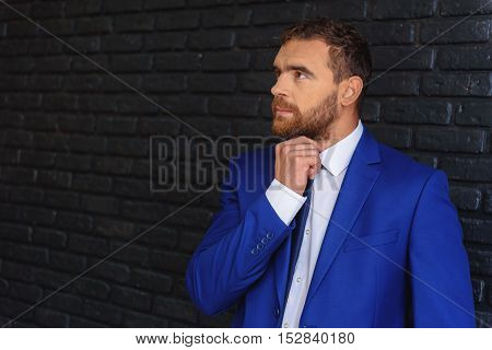 confident handsome guy looking left at copy space in restaurant