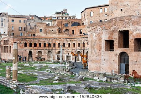 Roman forum ancient ruins in rome with metal horses, Italy