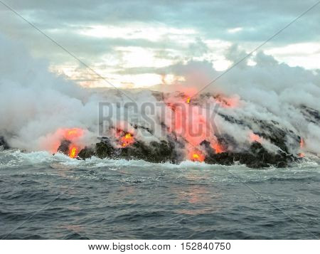 Smoke and steam given off by lava contact with the Pacific Ocean. Kilauea Volcano in Hawaii Volcanoes National Park, Big Island, Hawaii, Unites States.