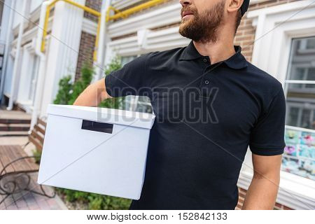 delivery man standing with a cargo, close up
