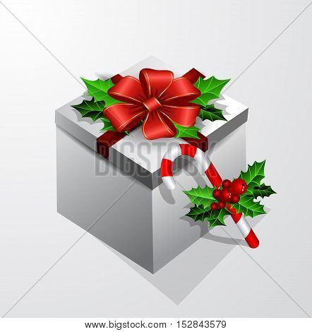 Gift box with bow isolated with holly leaves and candy cane