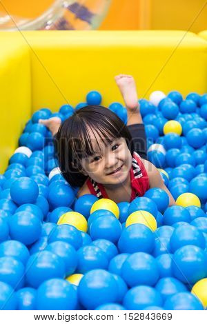 Asian Chinese Little Girl Playing At Balls Pool