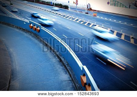 The Motion Blur Motion of Motor Car on the Turn of Highway.