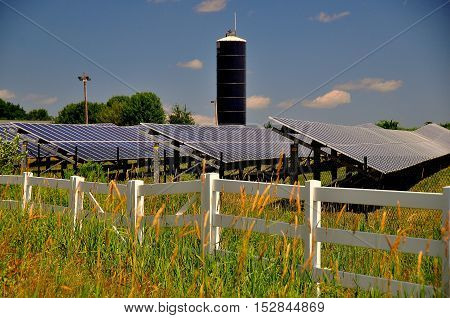 Connecticut - July 10 2015: Rows of solar panels soak up the sun at a Solar Energy Farm on a country road *