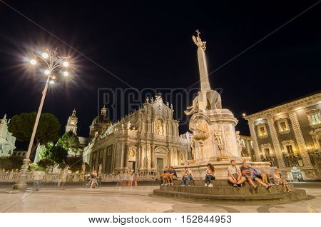 CATANIA ITALY - SEPTEMBER 14 2015: Night view of the Piazza del Duomo with the statue of the Elephant and the cathedral of Santa Agatha in Catania Sicily Italy.