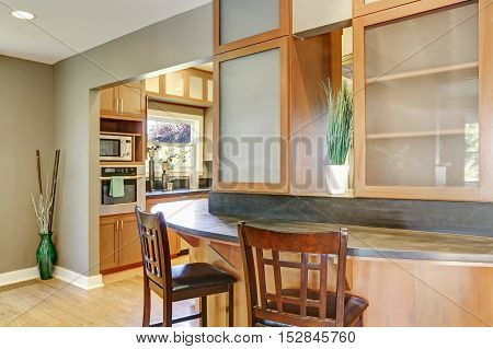House Interior. Close Up Of Bar Counter With Wooden Stools