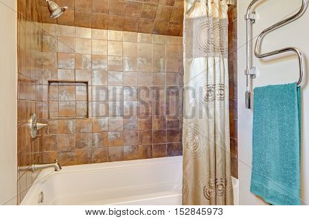 Close Up Of Shower With Natural Stone Tile Wall Trim